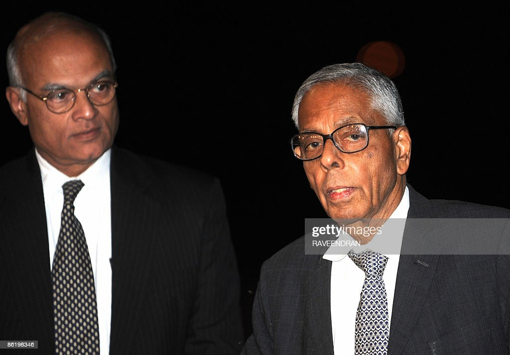 Indian National Security Adviser M.K. Narayanan (R) talks with journalists as Foreign Secretary Shivshankar Menon (L) looks on during their arrival at the New Delhi airport in New Delhi on April 24, 2009, following a visit to Sri Lanka. Amidst concern over the political fallout in Tamil Nadu of the ongoing army campaign in Sri Lanka's north, National Security Adviser M.K. Narayanan and Foreign Secretary Shivshankar Menon held talks with Sri Lankan President Mahinda Rajapaksa and discussed the situation in the country.
