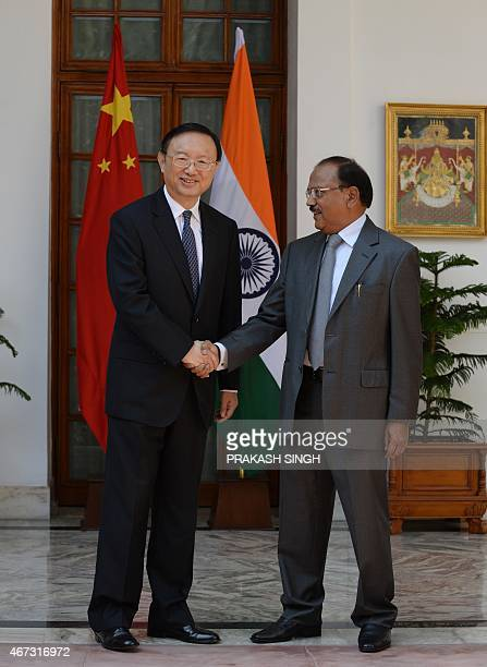 Indian National Security Advisor Ajit Doval shakes hands with State Councilor and Chinese Special Representative on IndiaChina Boundary Question Yang...