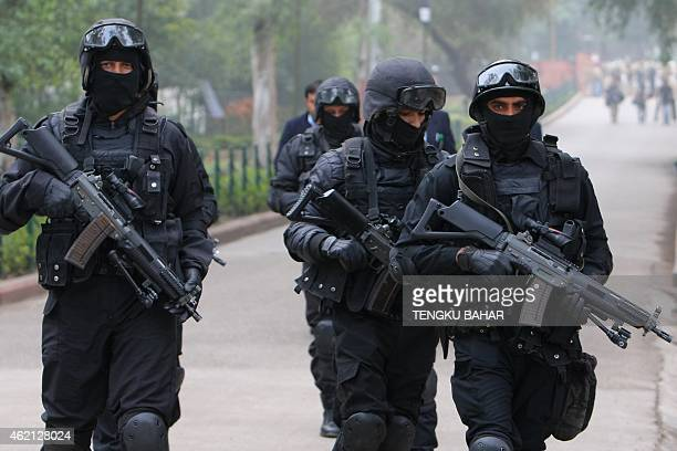 Indian National Security Guard commandos arrive to provide security ahead of US President Barack Obama's arrival at Raj Ghat the memorial for India's...