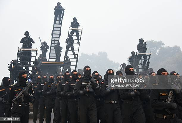 TOPSHOT Indian National Security Guard commandos rehearse for the forthcoming Republic Day parade on Rajpath in New Delhi on January 13 2017 India...