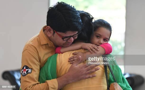Indian national Uzma Ahmed hugs her brother Wasim and daughter after her return from Pakistan at the Foreign Ministry in New Delhi on May 25 2017 An...