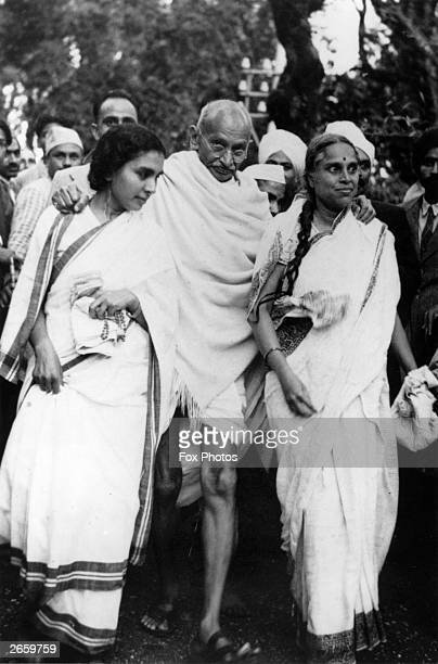 Indian nationalist leader Mahatma Gandhi leaving Maor Ville his Simla residence during the Leaders Conference He is helped to his car by his doctor...