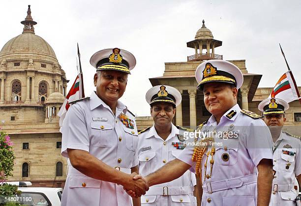 Indian Naval Chief Admiral Nirmal Verma shakes hands with Bangladesh's Chief of the Naval Staff Vice Admiral Zahir Uddin Ahmed prior to a meeting on...