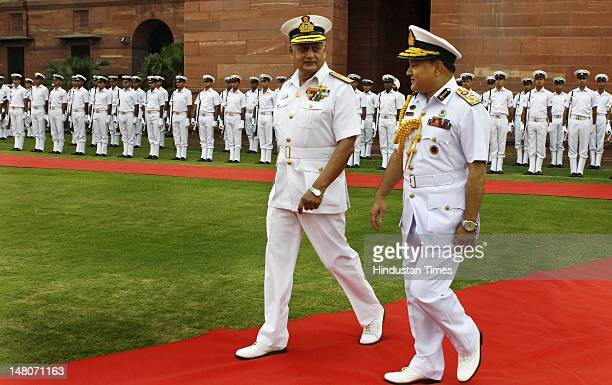 Indian Naval Chief Admiral Nirmal Verma talks with Bangladesh's Chief of the Naval Staff Vice Admiral Zahir Uddin Ahmed prior to a meeting on July 9...
