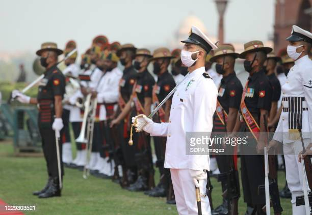 Indian Navy and Army wearing face masks take part during the joint military guard of honour at the ceremonial reception of the U.S. Defense Secretary...
