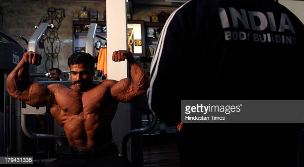 Indian Navy body builder Murali Kumar a winner of Mr Asia upto 100 Kg category held at Vietnam practices poses at media event at Pathare Gymco Parel...