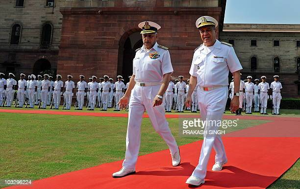 Indian Navy Chief Admiral Nirmal Verma gestures while talking with Commander of Brazilian Navy Admiral Julio Soares De Moura Neto after inspecting a...