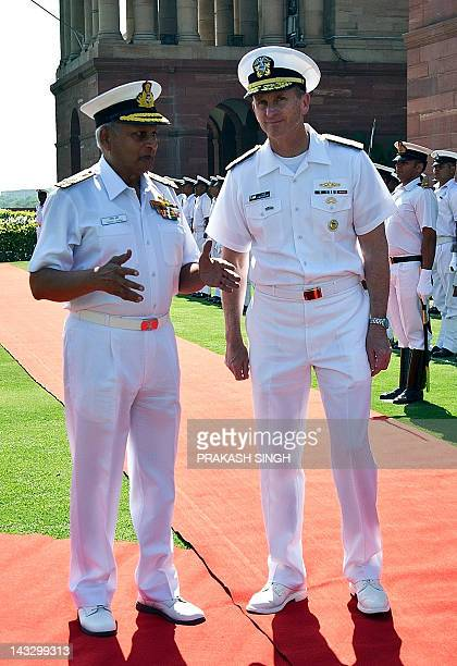 Indian Navy chief Admiral Nirmal Verma gestures while talking with US Navy Chief of Naval Operations Admiral Jonathan Greenert prior to a meeting in...