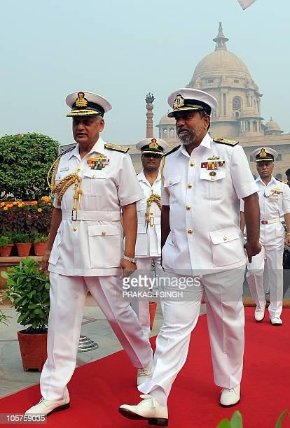 Indian Navy Chief Admiral Nirmal Verma talks with The Commander of Sri Lanka's Navy Vice admiral Thisara Samarasinghe in New Delhi on October 20 2010...