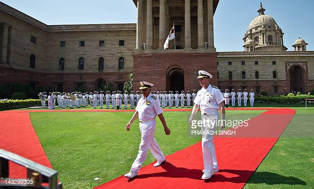 Indian Navy chief Admiral Nirmal Verma walks with US Navy Chief of Naval Operations Admiral Jonathan Greenert after inspecting a guard of honour...