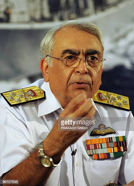 Indian Navy Chief Admiral Sureesh Mehta gestures during a press conference in New Delhi on August 27 2009 Vice Admiral Nirmal Kumar Verma presently...