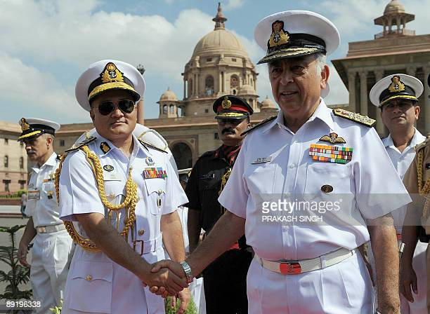 Indian Navy Chief Admiral Sureesh Mehta shakes hands with Chief of the Naval Staff Bangladesh Navy Rear Admiral Zahir uddin Ahmed in New Delhi on...