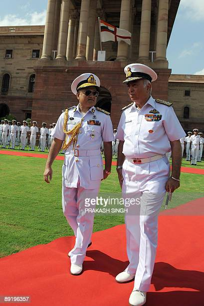 Indian Navy chief Admiral Sureesh Mehta talks with Chief of the Naval Staff Bangladesh Navy Rear Admiral Zahir uddin Ahmed after inspecting a Guard...