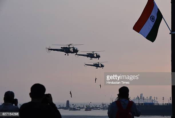 Indian Navy marine commandos demonstrate their skills during a rehearsal ahead of Navy Day celebrations at Gateway of India on December 1 2016 in...