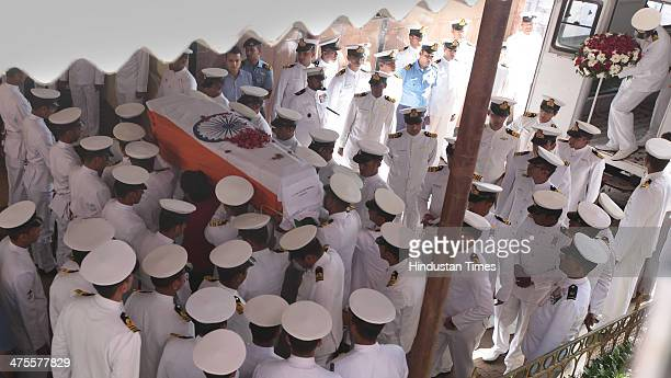 Indian Navy personal carry coffin of Lieutenant Commander Kapish Muwal during his funeral at Chandanwadi Crematorium at Marine Lines on February 28...
