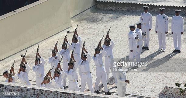 Indian Navy personal giving Guard of Honour at the Funeral of Lieutenant Commander Kapish Muwal takes place at Chandanwadi Crematorium at Marine...