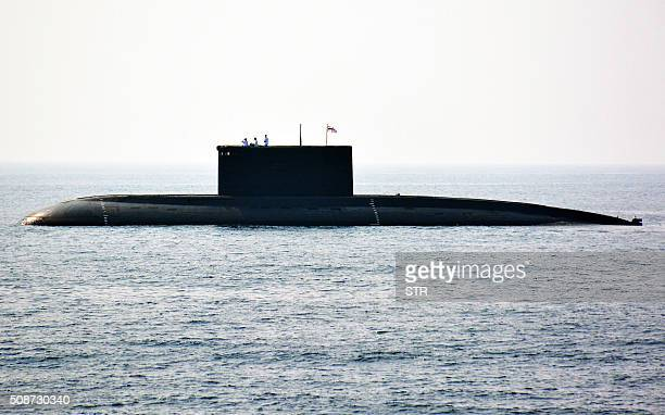 Indian Navy personnel stand on an Indian Navy submarine during the International Fleet Review in Visakhapatnam on February 6 2016 India kicked off a...