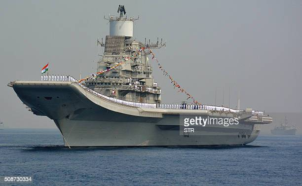 Indian Navy personnel stand on the INS Vikramaditya a modified Kievclass aircraft carrier during the International Fleet Review in Visakhapatnam on...