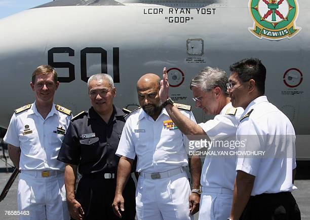 Indian Navy Rear Ddmiral R.R. Suthan listen to US Seventh Fleet commander William Crowder watched by Australian Navy Rear Admiral Nigel Coates ,...