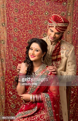 Indian Newlywed Couple In Traditional Wedding Dress Stock Photo