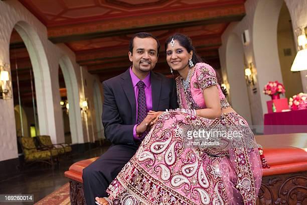 Indian newlywed couple smiling
