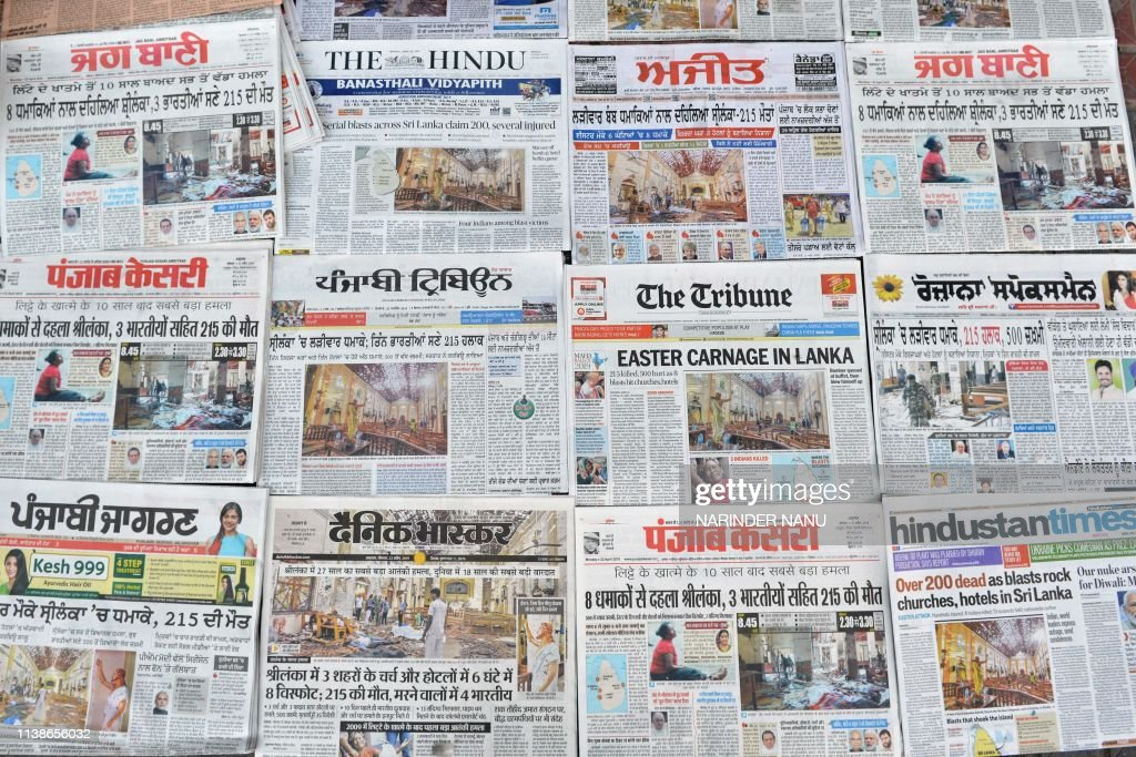 Indian newspapers displaying front page news on the Easter