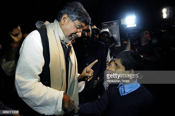 Indian Nobel laureate and child rights activist Kailash Satyarthi talks to children during a candle light vigil to end child slavery oragnized by NGO...