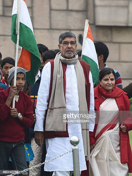 Indian Nobel Peace Prize winner Kailash Satyarthi along with his wife Sumedha arrive to pay tribute at Raj Ghat the memorial for India's founding...