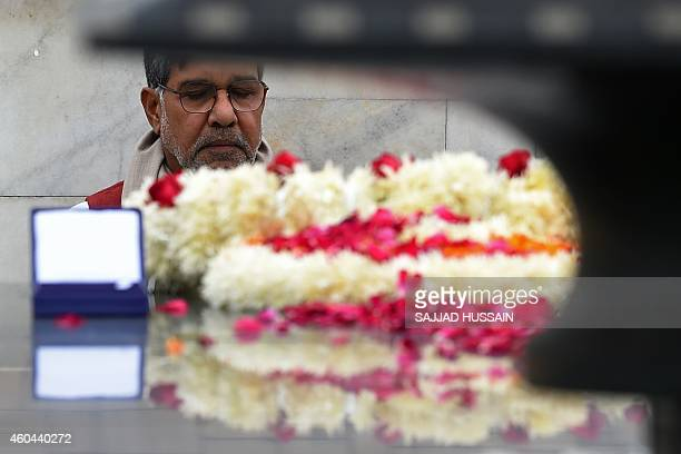 Indian Nobel Peace Prize winner Kailash Satyarthi is seen with his Nobel medal as he pays tribute at Raj Ghat the memorial for India's founding...