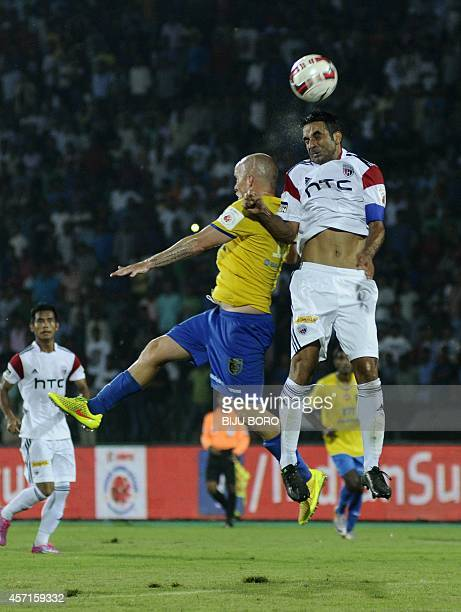 Indian North East United FC player Miguel Garcia heads the ball against Kerala Blasters FC during their Indian Super League football match in...