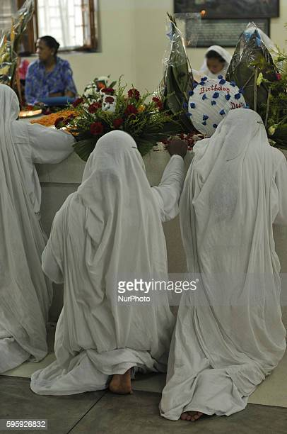 Indian nuns from the Catholic Order of the Missionaries of Charity take part in to commemorate the 106th birthday of Mother Teresa at the Indian...