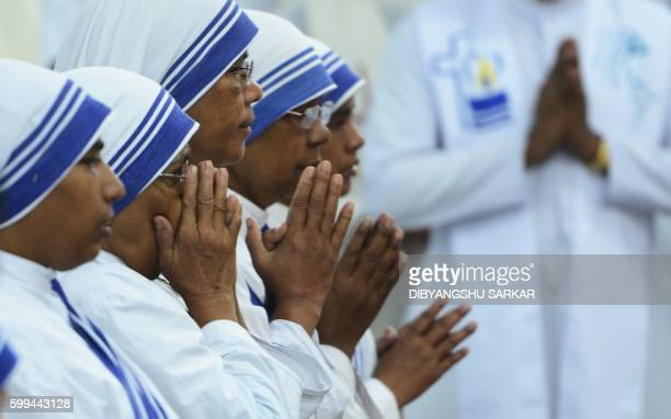 Indian nuns of the Catholic order of Missionaries of Charity attend a service to commemorate the 19th death anniversary of Mother Teresa at the...