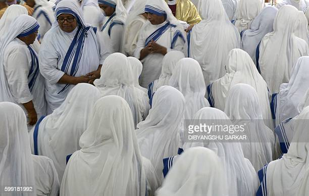 Indian nuns of the Missionaries of Charity participate in a special thanks giving mass at the Mother House in Kolkata on September 4 after the...