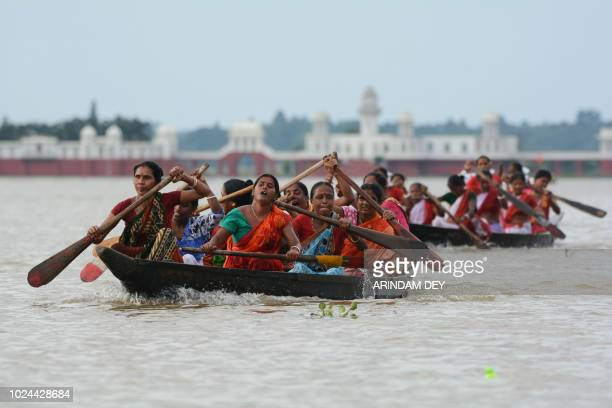 Indian oarswomen row during the traditional annual boat race festival at Rudra Sagar lake in Melaghar some 55 kms southeast of Agartala the capital...