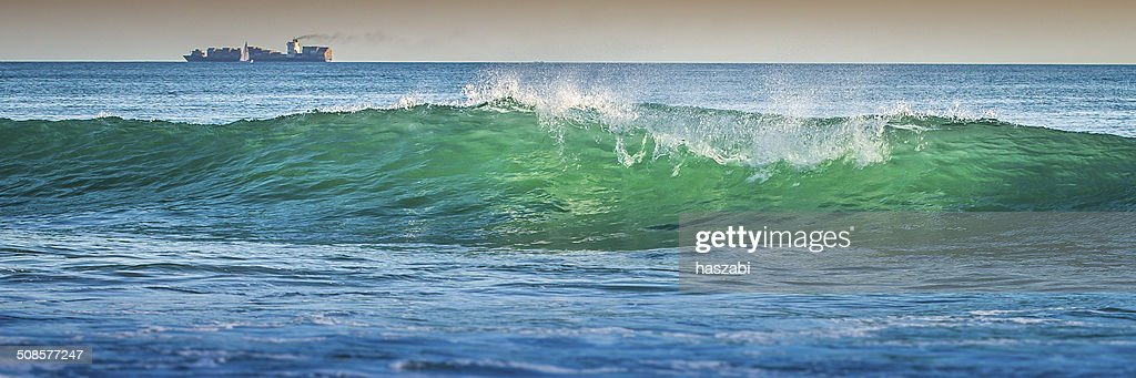 Indian ocean wave with boat : Stockfoto