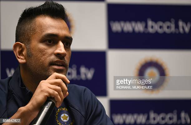 Indian ODI and T20 cricket captain Mahendra Singh Dhoni gestures during a press conference on the eve of the Indian tour of Zimbabwe in Mumbai on...