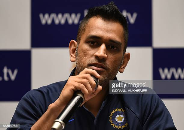 Indian ODI and T20 cricket captain Mahendra Singh Dhoni smiles during a press conference on the eve of the Indian tour of Zimbabwe in Mumbai on June...