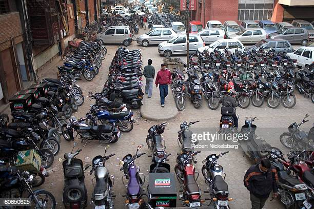 Indian office workers park their motorcycles in Nehru Park New Delhi India February 4 2008 Sales of motorcycles in India number nearly 600000 per...