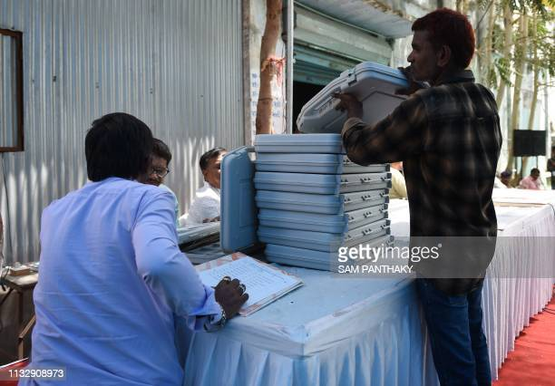 Indian officials on Election duty seen enaged in testing and distributing Electronic Voting Machines at a centre ahead of Lok Sabha election 2019 in...