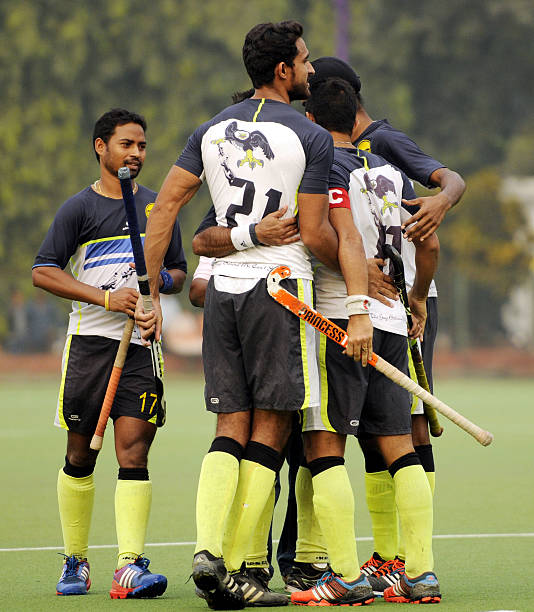 Indian Oil Corporation player cheers after defeating Punjab National Bank team during the final match of All India Beighton Cup Hockey Tournament on..