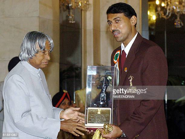Indian Olympic 2004 silver medalist Rajyavardhan Singh Rathore receives the prestigious Arjuna Award from Indian President APJ Abdul Kalam at the...