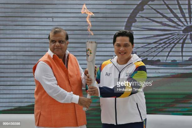 Indian Olympic Association President Narinder Batra with Chairman Indonesia Asian Games Organizing Committee Erick Thohir hold the torch during the...