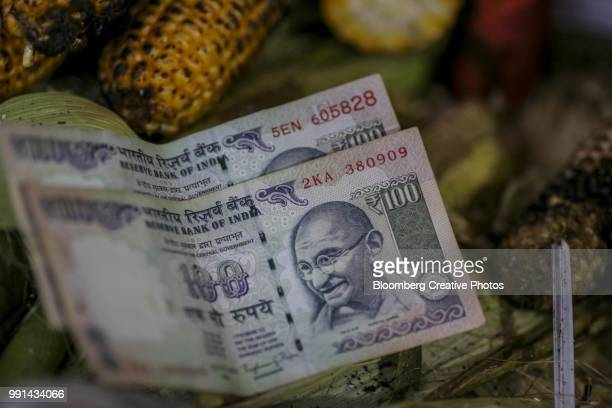 indian one hundred rupee banknotes - indian currency stock photos and pictures