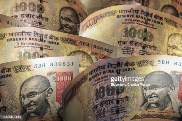 indian one thousand rupee banknotes - indian currency stock photos and pictures