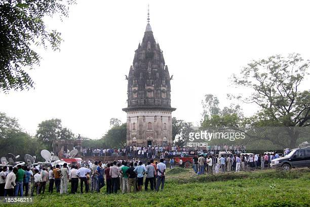 Indian onlookers watch as a team from state archaeological survey of India dig at the Raja Rao Ram Bux Singh temple at Daudiakala Khera village in...