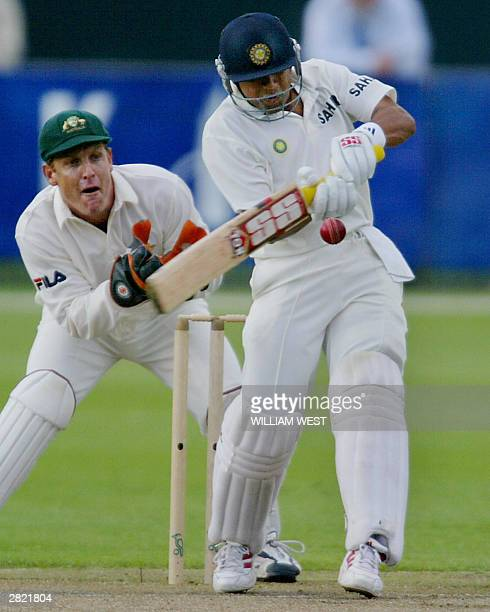 Indian opening batsman Akash Chopra pulls the ball away to the boundary as Australia 'A' wicketkeeper Wade Seccombe looks on during their match in...