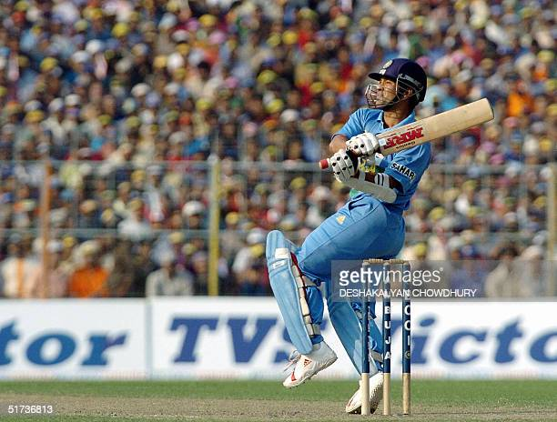 Indian opening batsman Sachin Tendulkar plays a shot during the One Day International match at the Eden Gardens Stadium in Calcutta 13 November 2004...