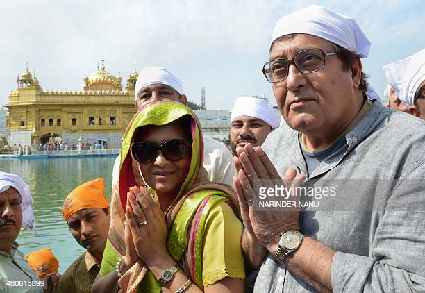 Indian opposition Bharatiya Janata Party parliamentary candidate for Gurdaspur and Bollywood actor Vinod Khanna and his wife Kavita pose for a...