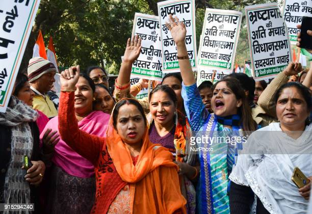 Indian opposition Congress party women workers chant anti-ruling government Aam Aadmi Party slogans demanding the resignation of ruling Aam Aadmi...