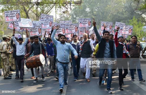 Indian opposition Congress party workers march to demand the resignation of ruling Aam Aadmi Party Delhi Chief Minister Arvind Kejriwal on corruption...
